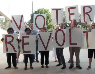 ChangeAustin Supporters holding signs that spell Voter Revolt