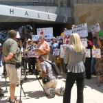 Former Travis County Judge, Bill Aleshire, with Austinites for Geographic Representation outside City Hall.